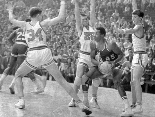 Century packages Sports LegendsWashington High SchoolÕs George McGinnis (45) finds himself surrounded by a trio of Silver Creek players during their game on March 15, 1969 at Hinkle Fieldhouse. Around McGinnis are Steve Green (34), Larry Stricker (22) and R.T. Green (right). This action was during the third period of a contest won by Washington. Staff photo by Frank Fisse