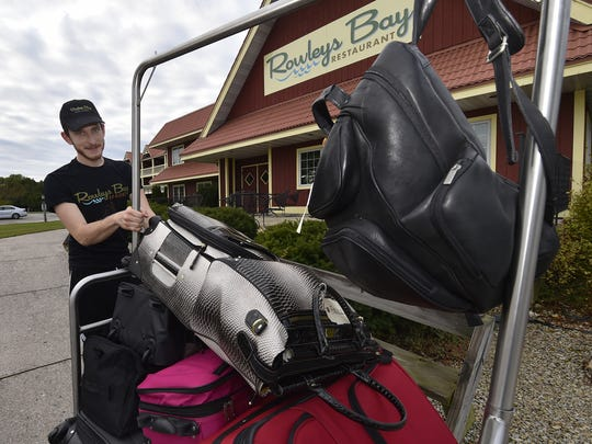 Ayhan Karabuga of Turkey transfers luggage into a vehicle at check-out Friday morning, Oct. 6, 2017, at Rowleys Bay Resort. There are three J-1 Visa students trained in all aspects of the hotel/restaurant industry at the Ellison Bay resort.