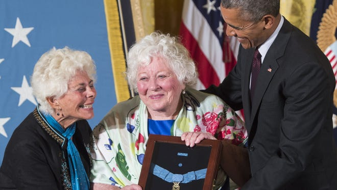 President Obama presents the Medal of Honor to Elsie Shemin-Roth, center, and Ina Bass, left, accepting on behalf of their late father, Army Sergeant William Shemin, for actions while serving in France during World War I, during a ceremony in the White House on June 2, 2015.