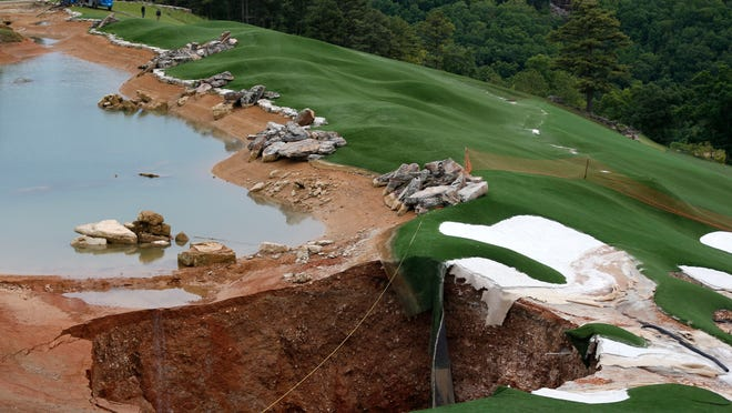 A large sinkhole opened up between the driving range and putting green at Top of the Rock golf course in Branson on Friday.