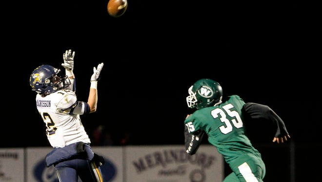 Haslett's Nate Magnusson snags a pass against Williamston's Jacob Christie October 16, 2015, enroute to a touchdown, giving Haslett a 13-0- lead over the Hornets.  Haslett won 28-7 at Williamston.
