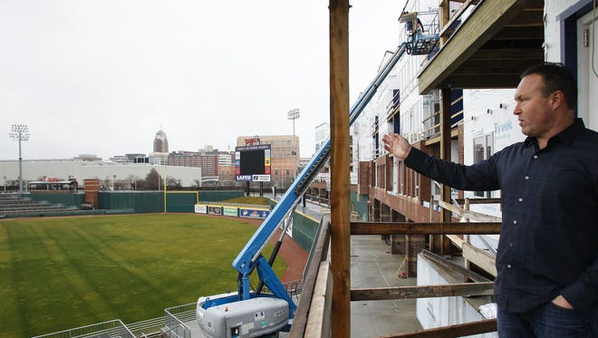 Pat Gillespie, founder and president of Gillespie Group, talks about his $11 million apartment project, The Outfield, from the balcony of one of the units under construction at Cooley Law School Stadium on Dec.22, 2015.
