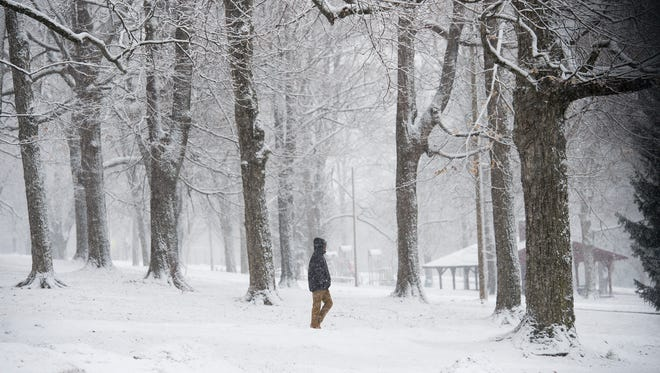 A student hurries across a snowy Farquhar Park in York on his way to school Tuesday. School was later dismissed early.