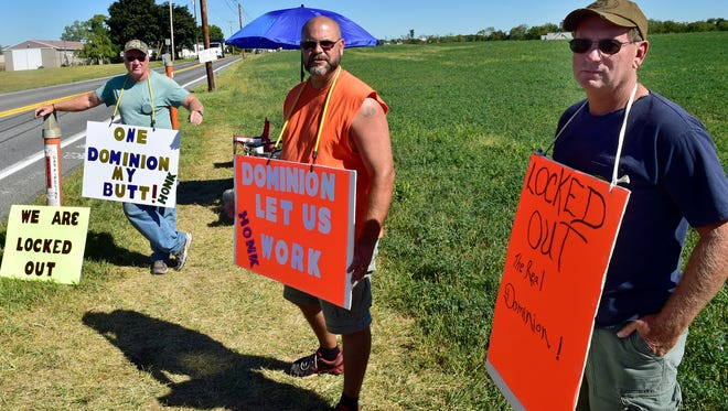 Dominion Transmission, Inc., workers Utility Workers Union of America (UWUA) Local 69 employees Gary Diehl, left, Mike Zinck and Dan Rummel picket in front of the Warm Spring Road, Hamilton Township, plant on Monday, September 12, 2016. The workers discovered they were locked out and not allowed on the property last Wednesday.