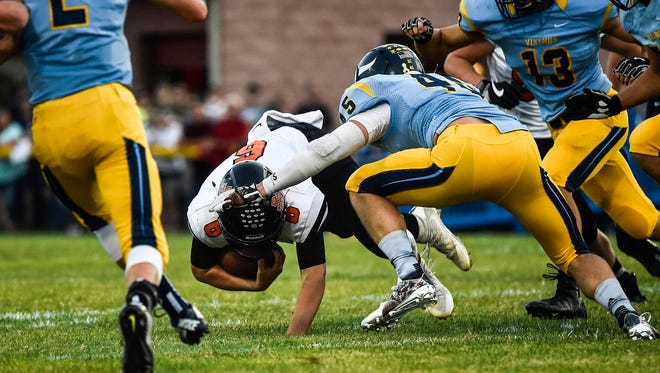 River Valley's Nash Fry (45) tackles North Union quarterback Tim Gilliland earlier this year. Fry leads the area in tackles with 104 as the Vikings go on the road Friday at 7 p.m. to Buckeye Valley.