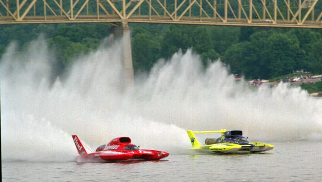 Miss Budweiser and Smokin Joe's blow through the starting line in the finals of the unlimited hydroplane race on July 2, 1995, in Madison, Ind.