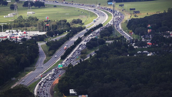 Florida residents flee Hurricane Irma as traffic backs up on  Northbound I-75 at its intersection with the Florida Turnpike on Thursday.