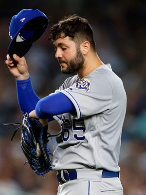 Kansas City Royals starting pitcher Jakob Junis (65) reacts against the New York Yankees during the fourth inning at Yankee Stadium.