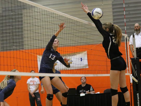 Colette Petric of IHA moves the ball over the net on
