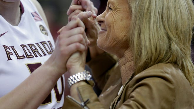 Florida State women's basketball coach Sue Semrau celebrates with center Chatrice white after FSU's 87-66 victory over Western Illinois in the first round of the NCAA tournament at the Donald L Tucker Civic Center Friday.