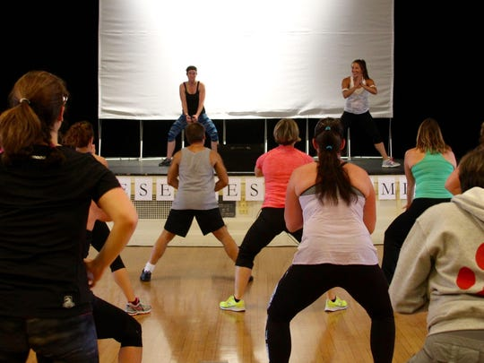 Zumbathon instructors take to the stage to show some moves.