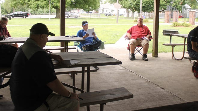 The athletics directors for schools in the Lincoln Trail Conference meet at Windmont Park in Kewanee to address shared scheduling concerns for the 2020-21 school year. They are spaced out to observe social distancing guidelines.