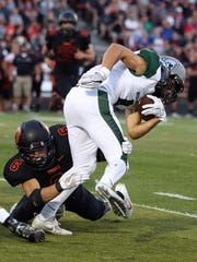 Sprague's Nathan Rediger tries to take down West Salem's Tyler Ballenger in a Greater Valley Conference game on Friday, Sept. 9, 2016, at Sprague High School. West Salem defeated Sprague 36-29.