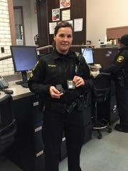 Cincinnati Police Specialist Yvonne Gutapfel shows