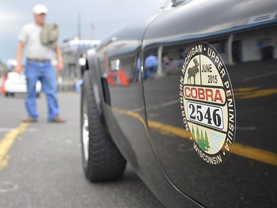 A vintage Shelby Cobra car waits in line to board the the S.S. Badger car ferry on Thursday in Manitowoc.