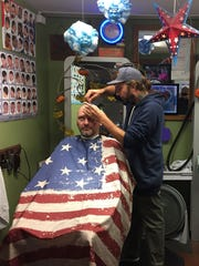 Daniel Hurley of Hurley's Salon and Barber Shop, shaves