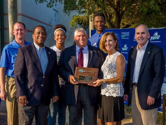 Dean and Janie Schreiner pose with FGCU coaches, players and administrators during the Alico Arena expansion project groundbreaking Nov. 4, 2016.