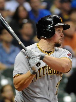 Pittsburgh Pirates right fielder Travis Snider lifted the Pirates to a 4-3 win, clinching their first non-losing season since 1992