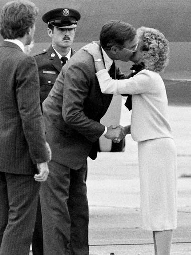 Vice President George Bush gets a kiss from Honey Alexander,
