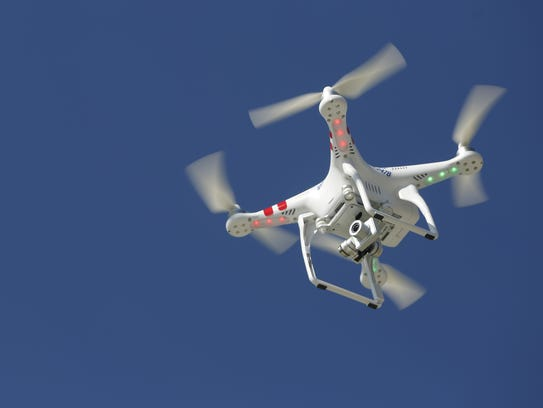 The Hunziker company drone glides in the air Monday,
