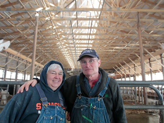 Henry Adams and wife Kerry Adams inside their large cattle barn at their Black Brook Farm.