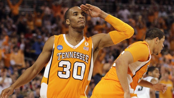 Former Vol guard J.P. Prince salutes after a basket while playing for Tennessee in 2010.
