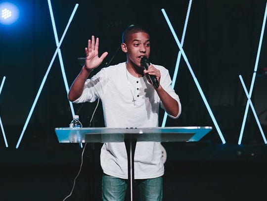 Malachi Walker, 13, speaks to youth at Covenant Church