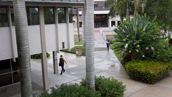 Edison State College students walk through the south Fort Myers campus.
