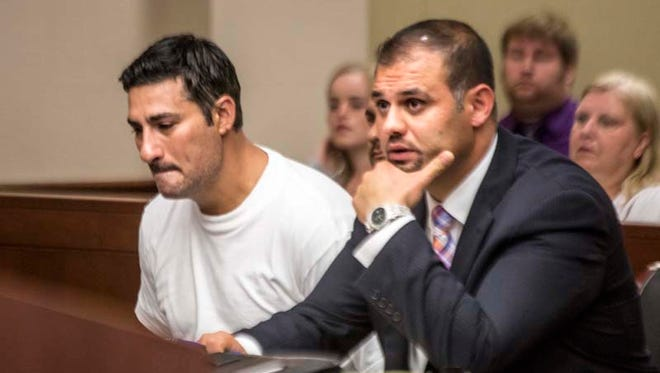 Bassel Saad, 36, of Dearborn (left) weeps silently beside defense attorney Ali Hammoud as he is charged with second-degree murder of an adult soccer league referee at 16th District Court in Livonia on July 10, 2014.
