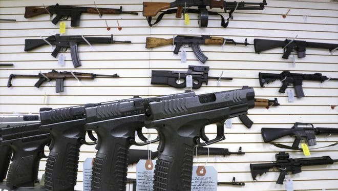 File photo of assault weapons and hand guns.