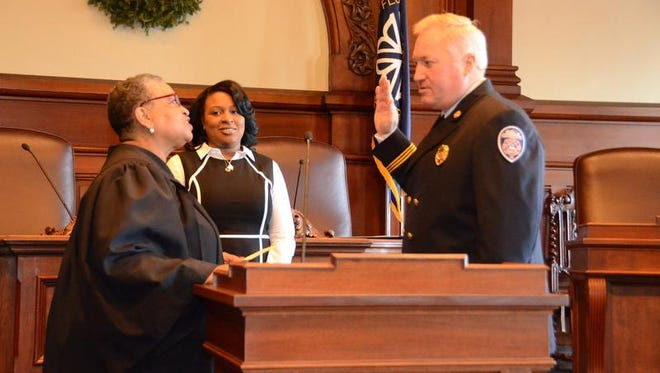 Interim Rochester Fire Chief John Schreiber is sworn in by City Court Judge Teresa Johnson.