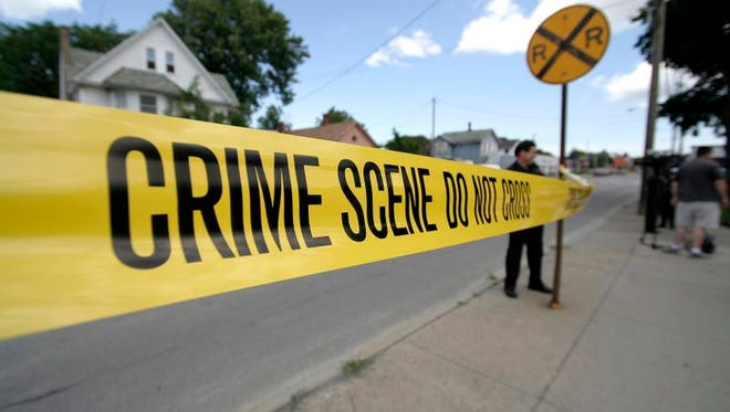 A file photo of police putting up yellow crime scene tape after an attempted robbery and shooting incident on Lyell Avenue in Rochester.