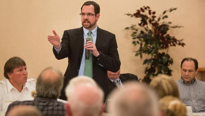 David Pidgeon, public relations manager for Norfolk Southern, speaks at a town hall meeting in Delaware City on rail safety and emergency response measures on Monday.