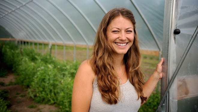 Lisa Baker stands in 2014 near the greenhouse located at her farm in Avon. Baker's Acres is one of many community-supported agriculture farms in Minnesota.