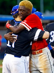 Rossview's Elijah Pleasants gets a hug from Brentwood's Caleb Pearson (17) after a 2018 TSSAA State Championships Class AAA baseball game Friday, May 25, 2018 in Murfreesboro, Tenn. (Photo by Wade Payne, Special to the Tennessean)