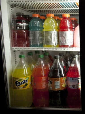 Bottles of soda and sugared sports drinks are for sale in a bodega in 2013 in New York's Chinatown.