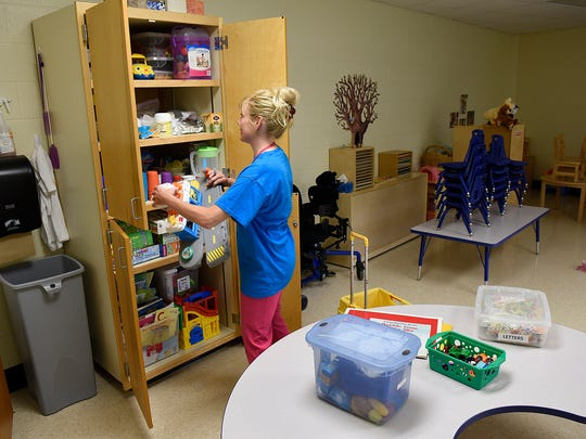 Early Childhood Education Speech Therapist Merith Starren puts toys into storage June 5 at Colts Academy in St. Joseph.