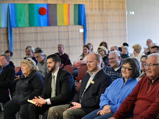 Area politicians and members of the community listen