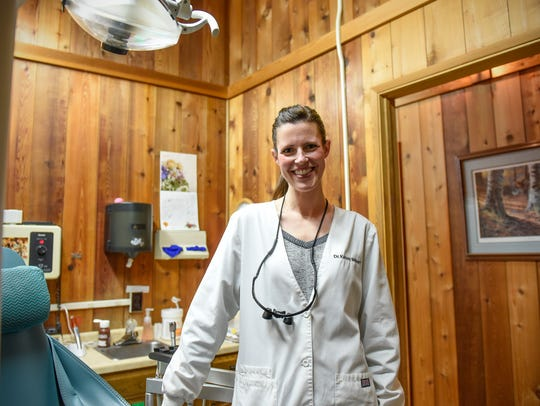 Dr. Kelsey Milbert smiles in one of the patient rooms