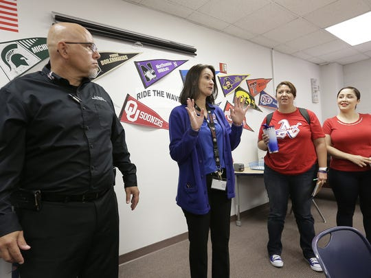 Americas High School counselor Joanne Kirtley shows her collegues the new Go Center.