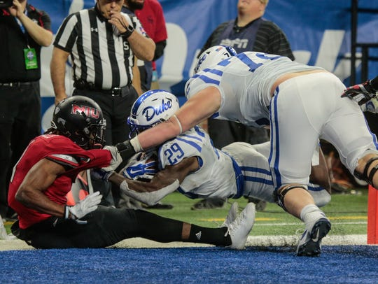Duke RB Shaun Wilson punches the ball into the end