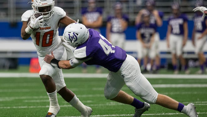 Refugio's Jacobe Avery dodges a tackle by Mason's Klay Klaerner during the third quarter of the Class 2A Division I state quarterfinal at the Alamodome in San Antonio on Friday, Dec. 8, 2017.