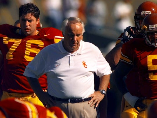 USC head coach John Robinson watches his team warm up before the start of their game against UCLA. November 23, 1997.