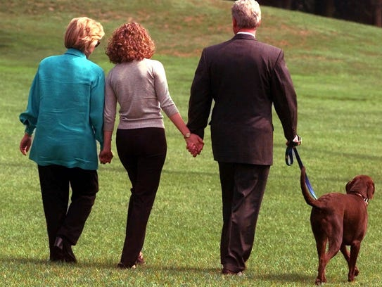 President Bill Clinton, his daughter Chelsea, and wife