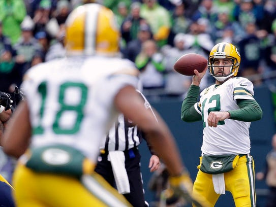 Green Bay Packers quarterback Aaron Rodgers (12) looks