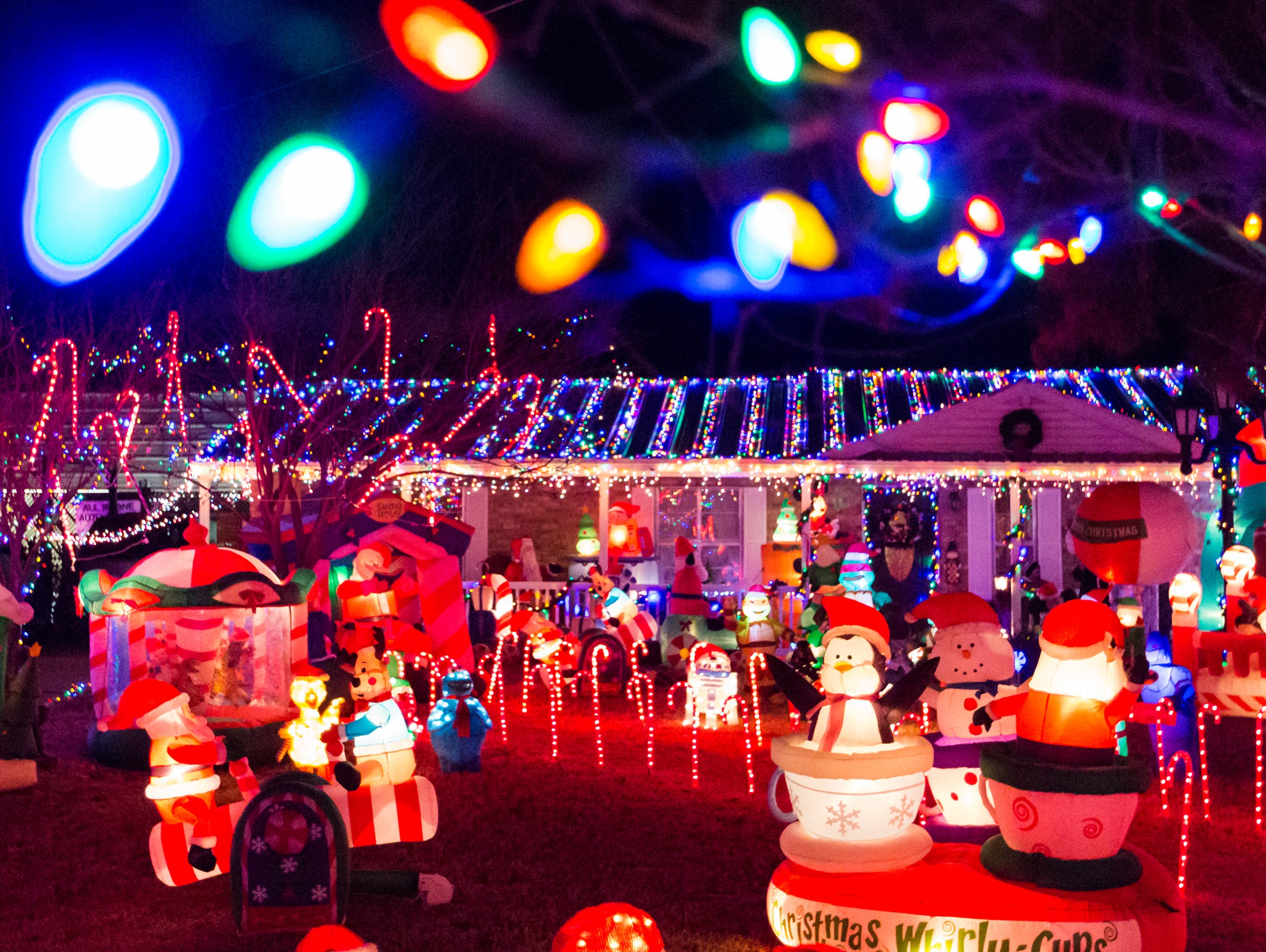 A large collection of Christmas lights and inflatables