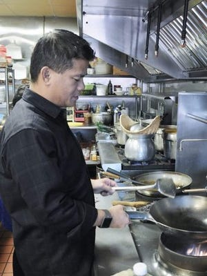 Photos courtesy Binh TranBinh Tran, shown above in the kitchen at his family's Sawan Thai Kitchen restaurant on Bainbridge Island, will be chef and owner of a new restaurant called Kachai Thai Kitchen that will open in Poulsbo in January. Some of his featured dishes are crispy calamari with sweet chili sauce (right).