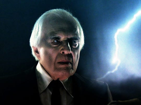 "The late Angus Scrimm – Biblically lit by flashes of lightning – makes his final appearance as the Tall Man in ""Phantasm Ravager."""