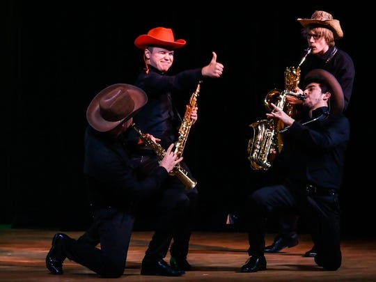 Based on their time as street musicians, the members of Five Sax include more than just music in their performances.