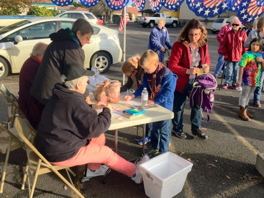 "Signing in at Turner Retirement Homes' first ""Walk for Veterans -- Walk n Roll"" Wednesday. The walk drew dozens who set out on one of three courses: 1/4 mile, 1 mile and 3 mile walks. Proceeds benefit the Fallen Heroes Fund."